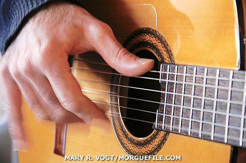 strumming guitarist